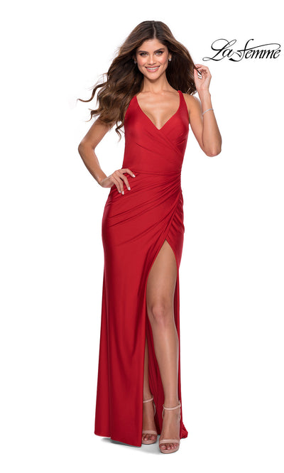 La Femme LF28289 long red prom tight fitted sexy prom dress with open back & high slit. This red sleek and sexy, low back formal full length evening gown with leg slit is perfect for 2020 prom dresses