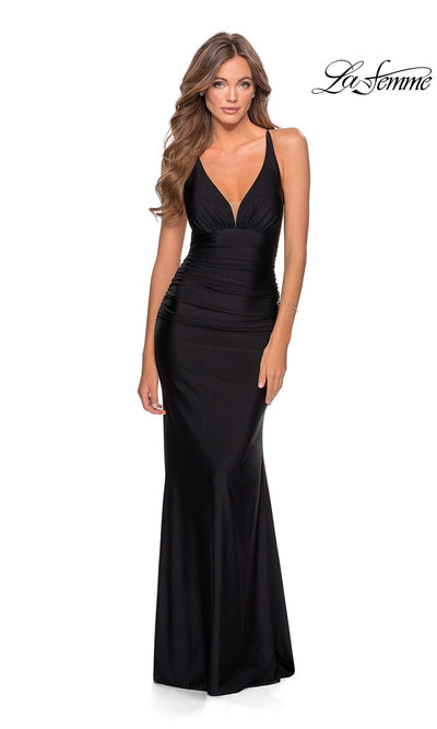 La Femme LF28297 long black prom tight fitted sexy prom dress with open back & low v neck. This black sleek and sexy, low back formal full length evening gown with leg slit is perfect for 2020 prom dresses