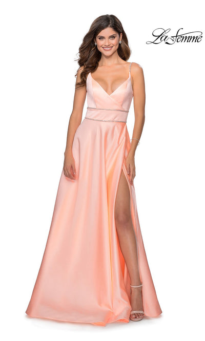 La Femme LF28385 long peach prom dress with flowy, a-line skirt, open back, and high slit. This light orange low back formal full length evening gown with leg slit is perfect for 2020 prom