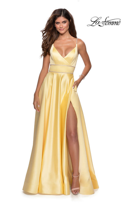 La Femme LF28385 long yellow prom dress with flowy, a-line skirt, open back, and high slit. This light yellow low back formal full length evening gown with leg slit is perfect for 2020 prom