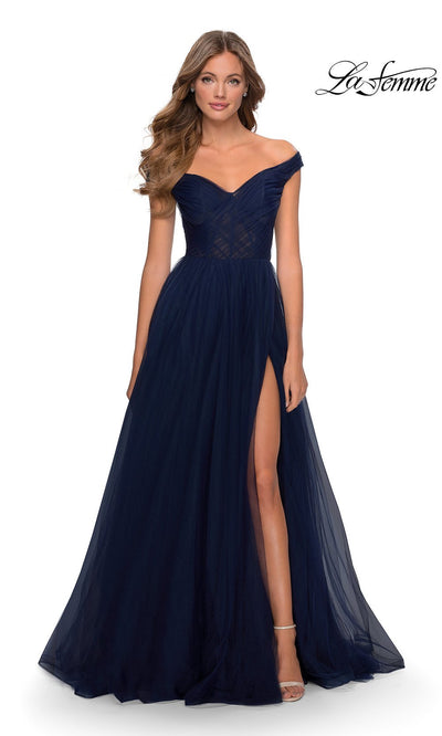 La Femme LF28462 long navy blue tulle prom flowy dress with high slit and off shoulder neckline. This dark blue flowy, simple a-line formal full length tulle evening gown with leg slit is perfect for 2020 prom dresses