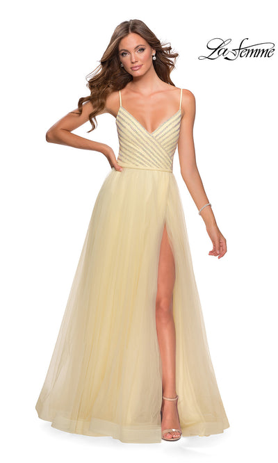 La Femme LF28511 long pale yellow prom flowy tulle prom dress with high slit & beaded v neckline top with straps. This light yellow princess semi ballgown a-line formal full length evening gown with leg slit is perfect for 2020 prom
