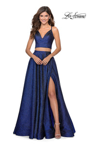 La Femme LF28618 long two piece marine blue prom flowy, simple dress. This 2 piece gown has a flowy skirt with a high slit & an open back v neckline top with straps. This metallic blue formal crop top & fitted skirt is perfect for 2020 prom dresses