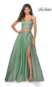 La Femme LF28618 long two piece mint green prom flowy, simple dress. This 2 piece gown has a flowy skirt with a high slit & an open back v neckline top with straps. Metallic light green formal crop top & fitted skirt is perfect for 2020 prom dresses