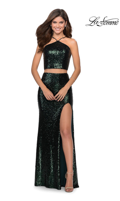 La Femme LF28623 long two piece emerald green prom fitted sleek and sexy dress. This 2 piece beaded gown has fitted skirt with a high slit, high neck top, high slit. This dark green formal crop top & fitted skirt is perfect for 2020 prom dresses