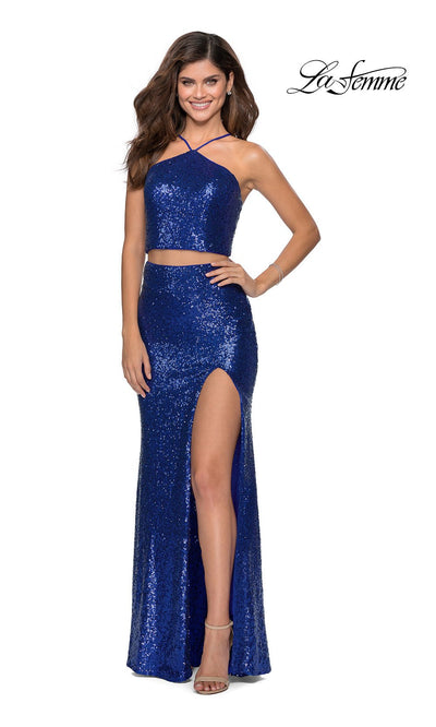 La Femme LF28623 long two piece royal blue prom fitted sleek and sexy dress. This 2 piece beaded gown has fitted skirt with a high slit, high neck top, high slit. This royal blue formal crop top & fitted skirt is perfect for 2020 prom dresses