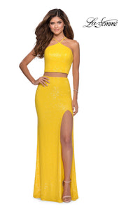 La Femme LF28623 long two piece yellow prom fitted sleek and sexy dress. This 2 piece beaded gown has fitted skirt with a high slit, high neck top, high slit. This yellow formal crop top & fitted skirt is perfect for 2020 prom dresses