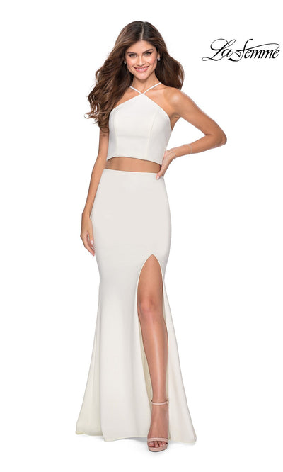 La Femme LF28624 long two piece white prom fitted sleek and sexy, simple dress. This 2 piece gown has a fitted mermaid skirt with high slit and open back high neckline. This white formal crop top & fitted skirt is perfect for 2020 prom dresses