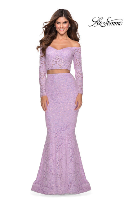 La Femme LF28666 long two piece lavender prom fitted sleek and sexy, simple dress. This 2 piece gown has a fitted mermaid skirt & long sleeve off shoulder top. This light purple or lilac formal crop top & fitted skirt is perfect for 2020 prom dresses