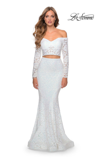 La Femme LF28666 long two piece white prom fitted sleek & sexy, simple dress. This 2 piece gown has a fitted mermaid skirt & long sleeve off shoulder top. This white lace formal crop top & fitted skirt is perfect for 2020 prom dresses