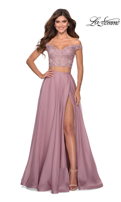 La Femme LF28704 long two piece mauve pink prom flowy, simple dress. This 2 piece gown has a flowy chiffon skirt with high slit & off shoulder lace neckline top. Light pink or dusty rose formal crop top & fitted skirt is perfect for 2020 prom dresses