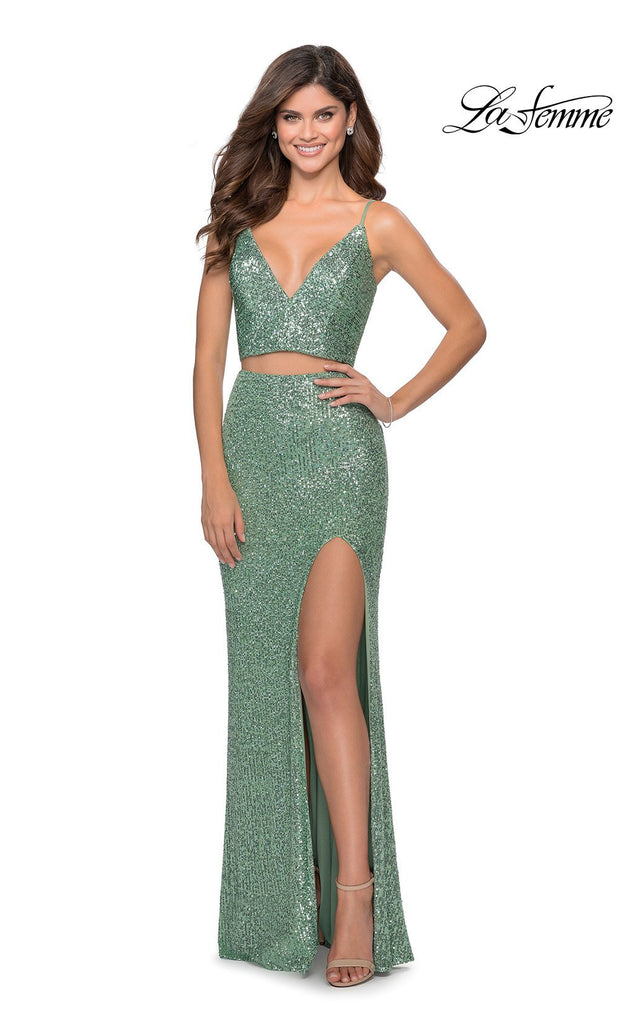 La Femme LF28870 long two piece mint green prom fitted sequin beaded dress. This 2 piece gown has a fitted mermaid skirt with high slit and v neckline with straps. This light green formal full length evening gown is perfect for 2020 prom dresses
