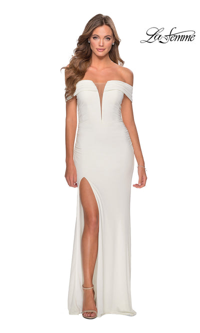 La Femme LF 28132 long white prom tight fitted sexy prom dress with high slit and off shoulder. This white sleek and sexy, low v neck formal full length evening gown with leg slit is perfect for 2020 prom