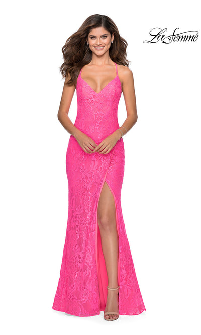 La Femme LF 28548 long neon pink prom tight fitted sexy prom lace dress with open back, high slit, and v neckline. This bright pink or hot pink sleek and sexy, low back formal full length evening gown is perfect for 2020 prom