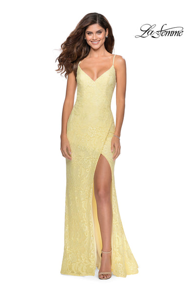 La Femme LF 28548 long pale yellow prom tight fitted sexy prom lace dress with open back, high slit, and v neckline. This light yellow sleek and sexy, low back formal full length evening gown is perfect for 2020 prom