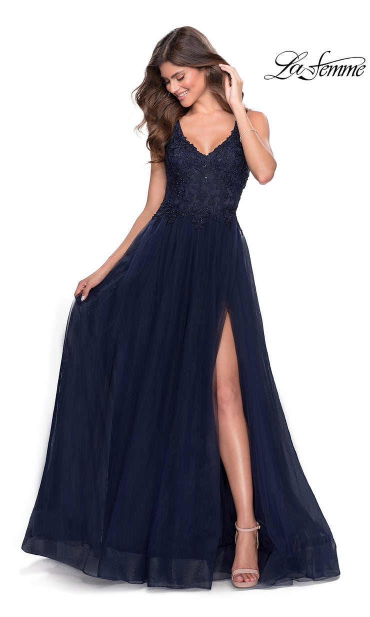 La Femme LF 28680 long navy blue prom flowy chiffon prom dress with high slit, v neckline with straps. This dark blue a-line formal full length evening gown with leg slit, lace top & open back is perfect for 2020 prom dresses