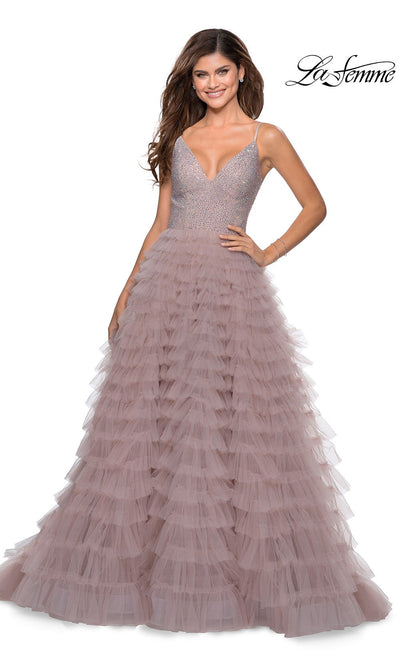 La Femme LF 28788 long mauve pink prom flowy tulle prom dress with fringe, high slit, v neckline with straps. This dusty rose or light pink a-line formal full length evening beaded gown is perfect for 2020 prom dresses