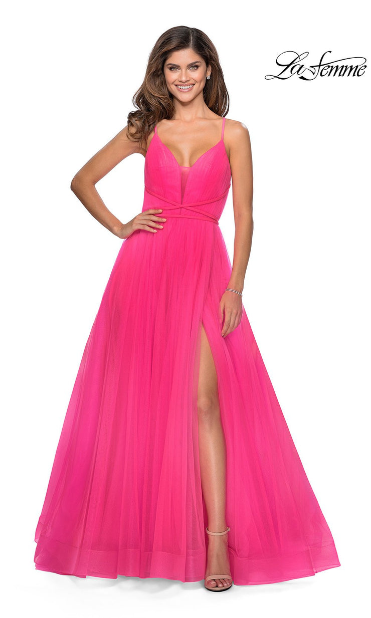 La Femme LF 28893 long neon pink prom flowy chiffon prom dress with high slit, v neck, & open back. This hot pink or bright pink a-line formal full length evening gown is perfect for 2020 prom dresses
