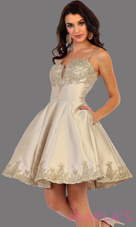Short satin champagne grade 8 graduation dress with gold lace detail and straps. This dress features pockets. Perfect light gold short prom dress, confirmation dress, damas, and wedding guest dress. Available in plus sizes.