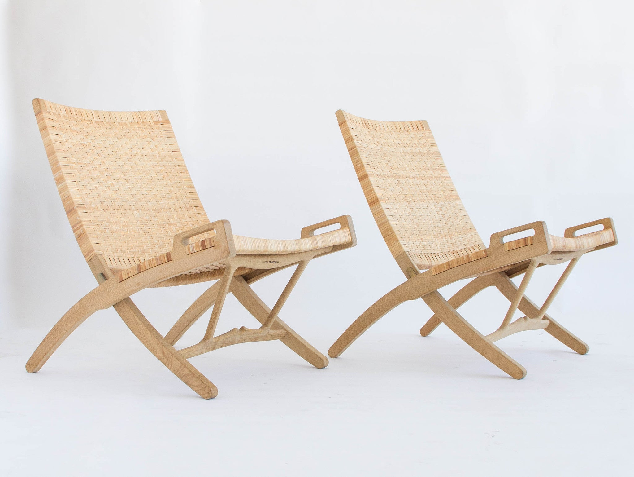 Pair of Oak and Cane Folding Lounge Chairs by Hans Wegner for PP