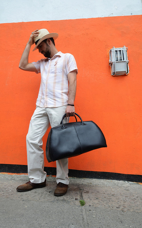 Jerry with panama hat and Vega Overnight Bag