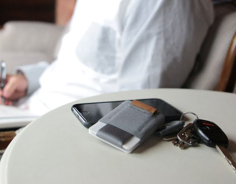 gray nomatic wallet on a desk
