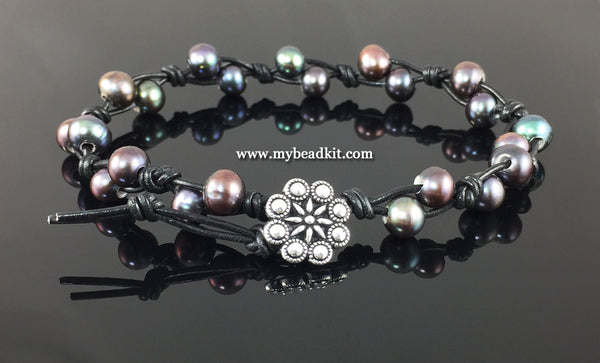 Photo shows bracelet described in this kit. Black knotted leather with gray / purple pearls and a silver tone button closure.