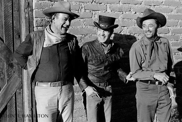 John Wayne, James Caan and Robert Mitchum joking around during the filming of El Dorado.  [1966]