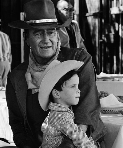 "John Wayne and son Ethan on the set of ""El Dorado.""  Old Tucson, AZ  [1966]"