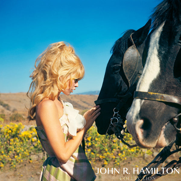"Brigitte Bardot with horses in Mexico on set of ""Viva Maria."""
