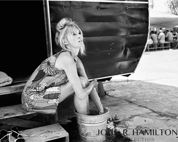 "Brigitte Bardot cools her feet during a break in filming ""Viva Maria.""  1964"