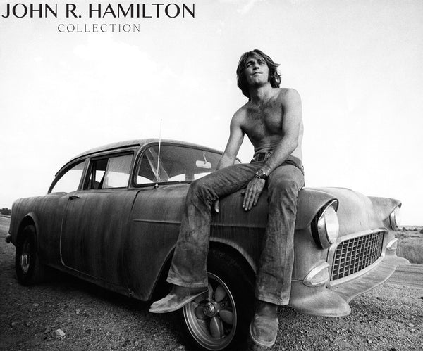"Dennis Wilson (drummer, singer, composer for the Beach Boys) on set on top a 1955 Chevy during his motion picture debut as an actor in ""Two-Lane Blacktop.""  [1970]"