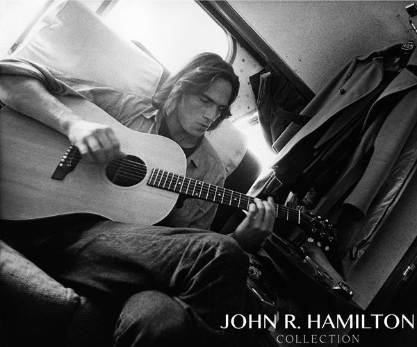 "James Taylor playing guitar during a break filming ""Two Lane Blacktop.""  [1971]."