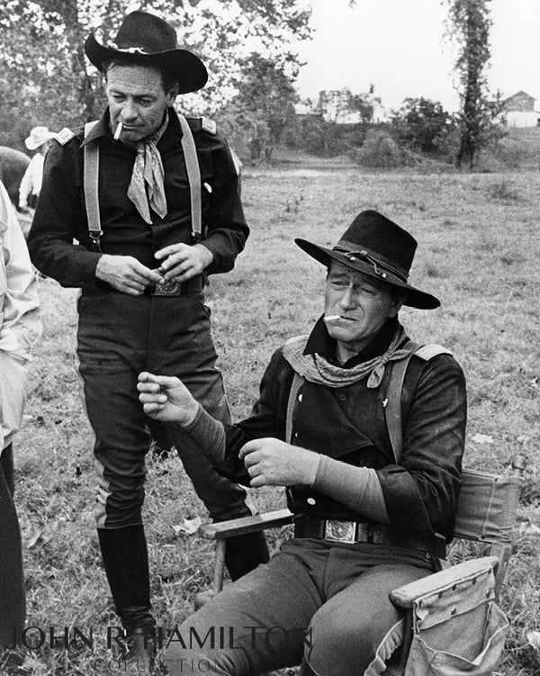 "John Wayne and William Holden, during the filming of ""The Horse Soldiers.""  Louisiana.  [1959]"