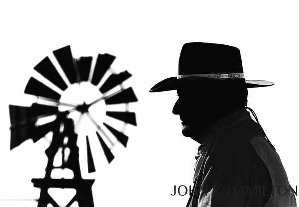 "John Wayne with windmill in background during filming of ""El Dorado"" in Old Tucson, AZ.  1967"