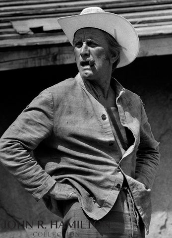 "Kirk Douglas in sombrero during filming of ""There was a Crooked Man""  [1970]"