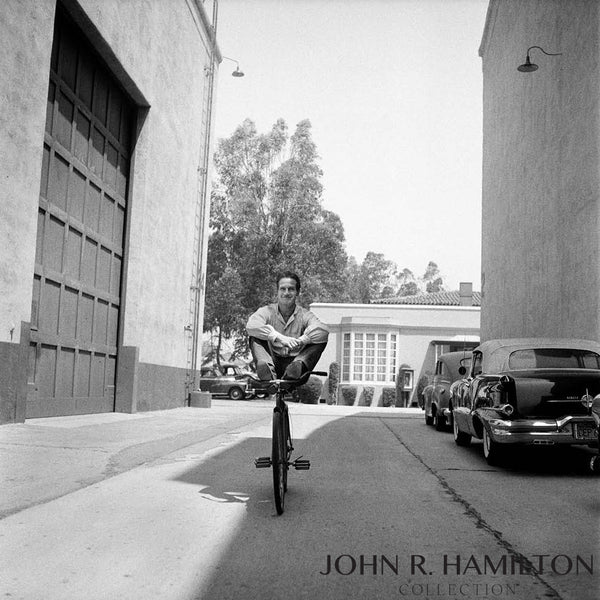 Paul Newman on bike, no hands.  Warner Bros lot.  1958