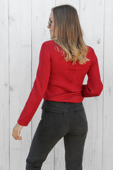 despite knitted top in red