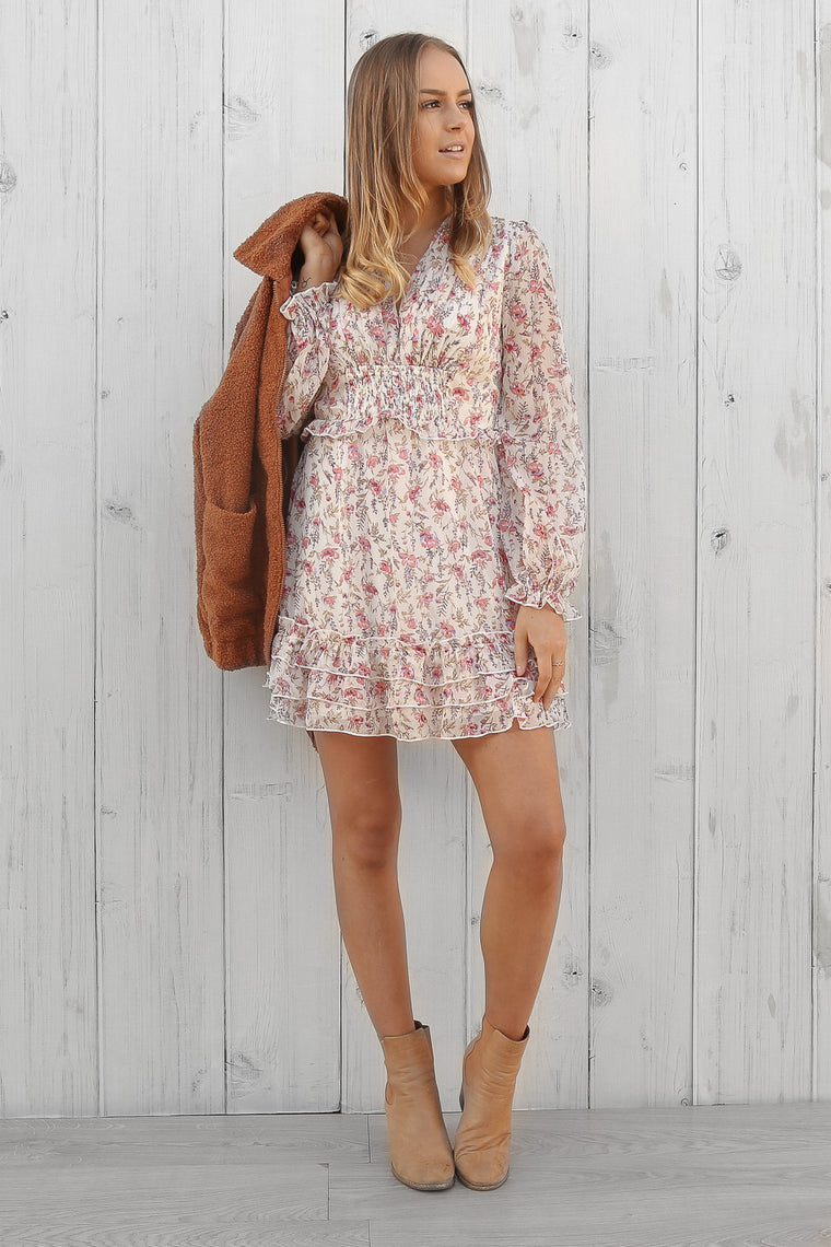 changing dress in pink floral