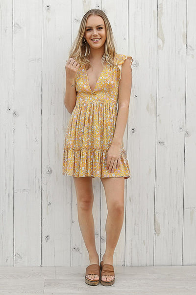 determined mini dress in yellow