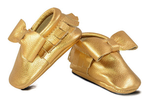 Gold Bow Moccasins Size 6