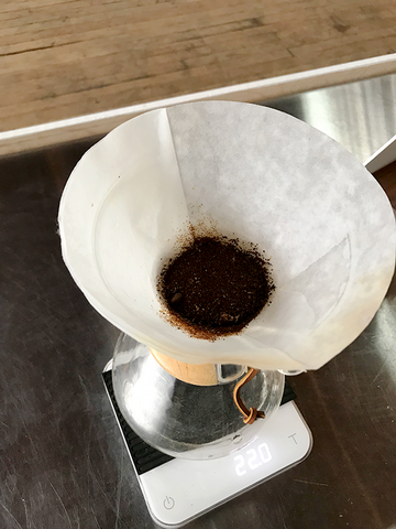Chemex on scale with coffee grounds and filter