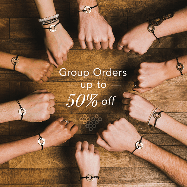 A group wearing their MyIntent Custom Black String Bracelets each unique with their on words