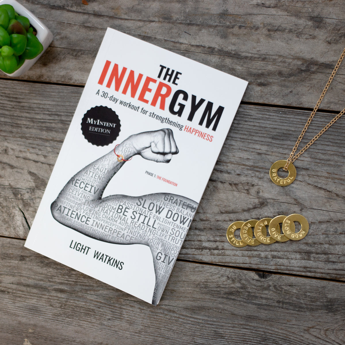 The Inner Gym book with a MyIntent brass chain necklace with 6 tokens each with an own unique word