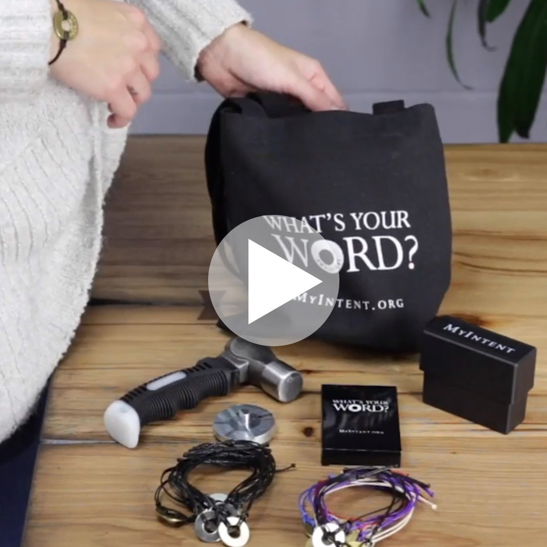 A lady unpacking her MyIntent Maker Kit from the MyIntent tote bag