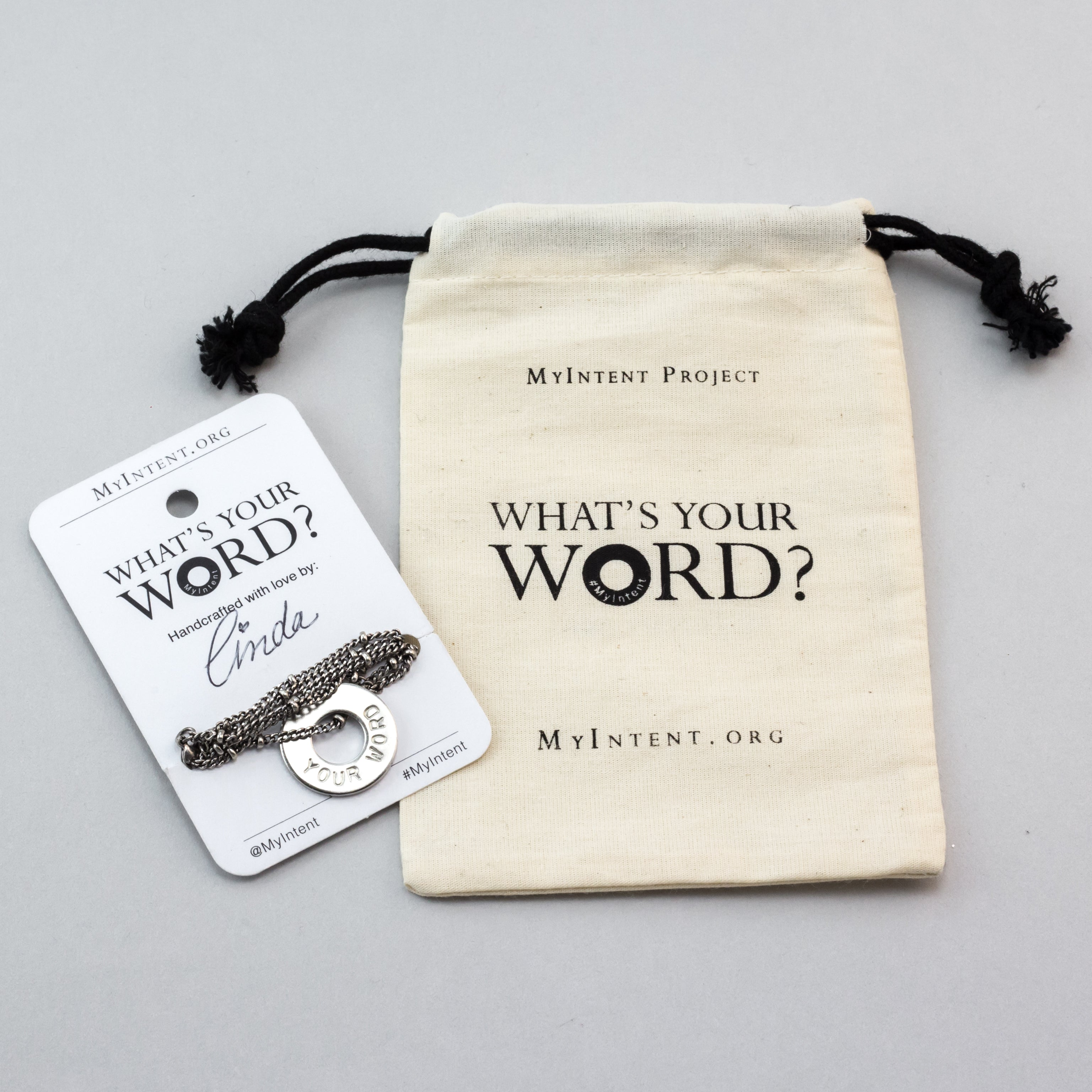 MyIntent Custom Bead Necklace arrives wrapped around a card with Packaging Bag