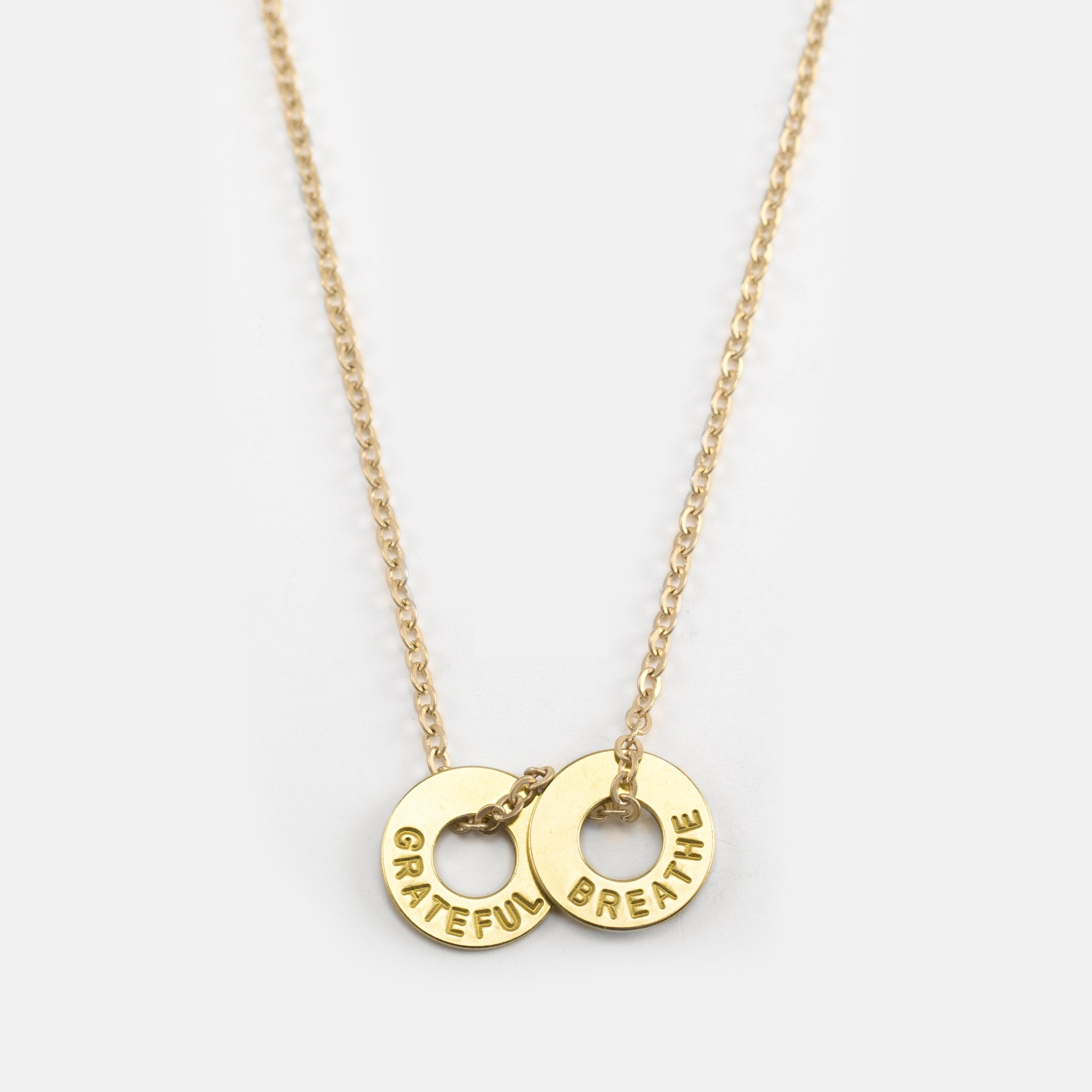 MyIntent Gratitude Pack necklaces has 2 chain brass necklaces with the words GRATEFUL & BREATHE