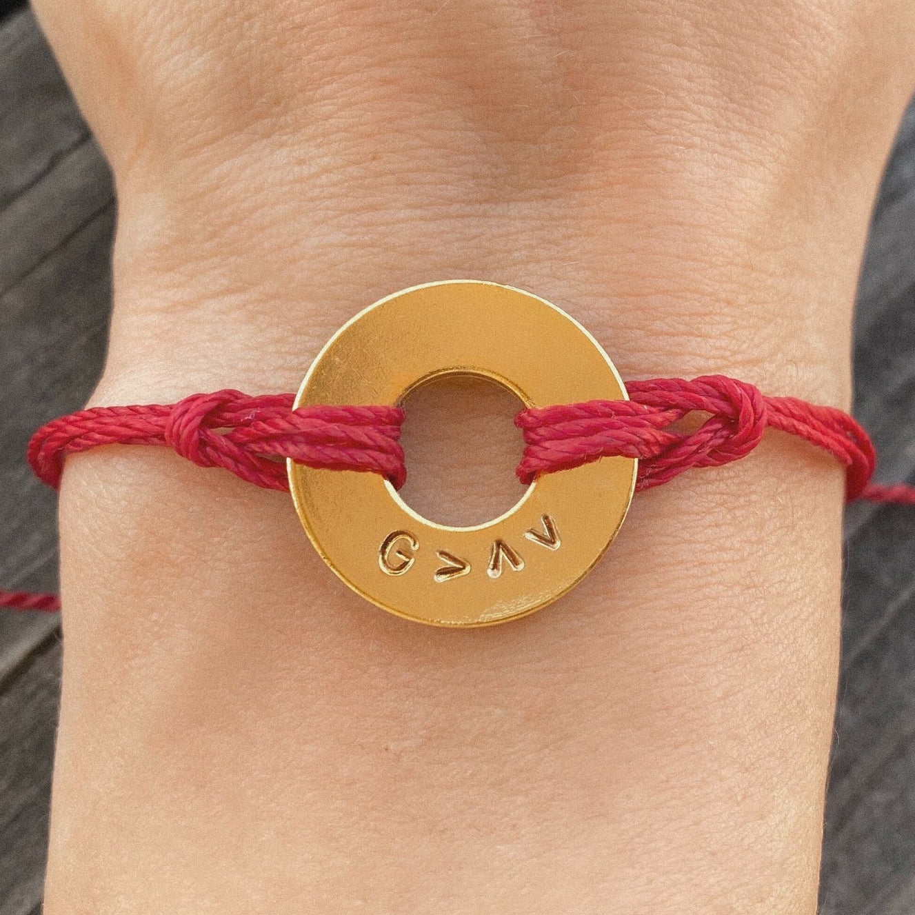 A person sharing why they chose their custom message, G>^v, on their MyIntent Custom Twist Red Bracelet with Gold Token