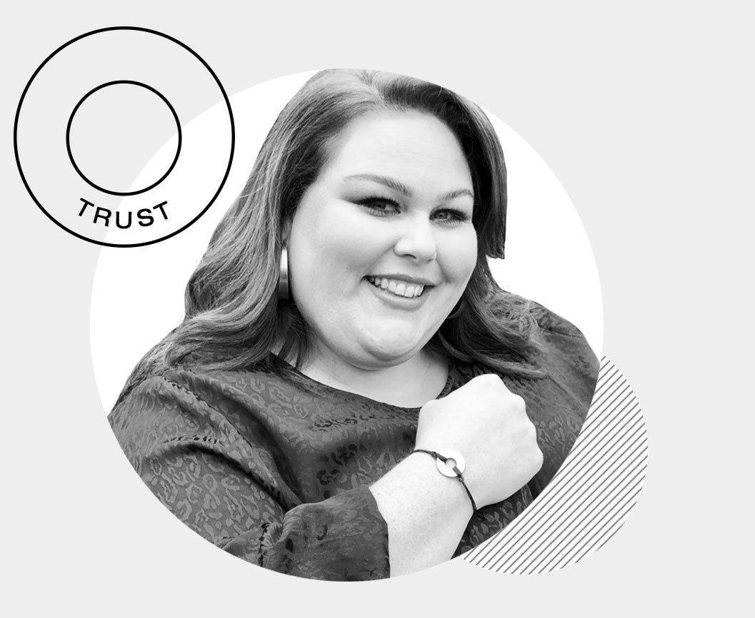 Chrissy Metz wearing her MyIntent bracelet with the word TRUST