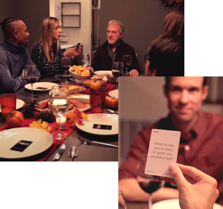 A family reading questions from the MyIntent Question cards at the dinner table and sharing stories